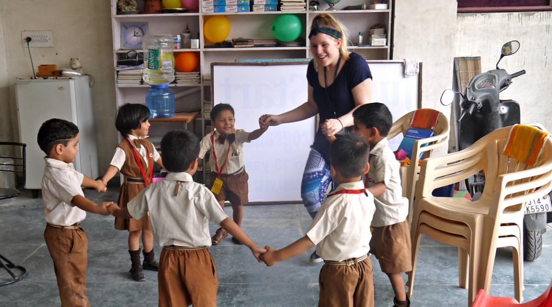 Childcare volunteer plays an educational game in class during her volunteer work experience with children in India.